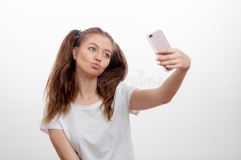 Lovely awesome girl blowing kiss while taking a picture stock photography