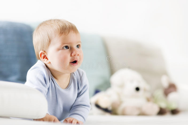 Download Lovely Baby Boy Lying On Belly And Looking Up. Stock Image - Image: 35198079