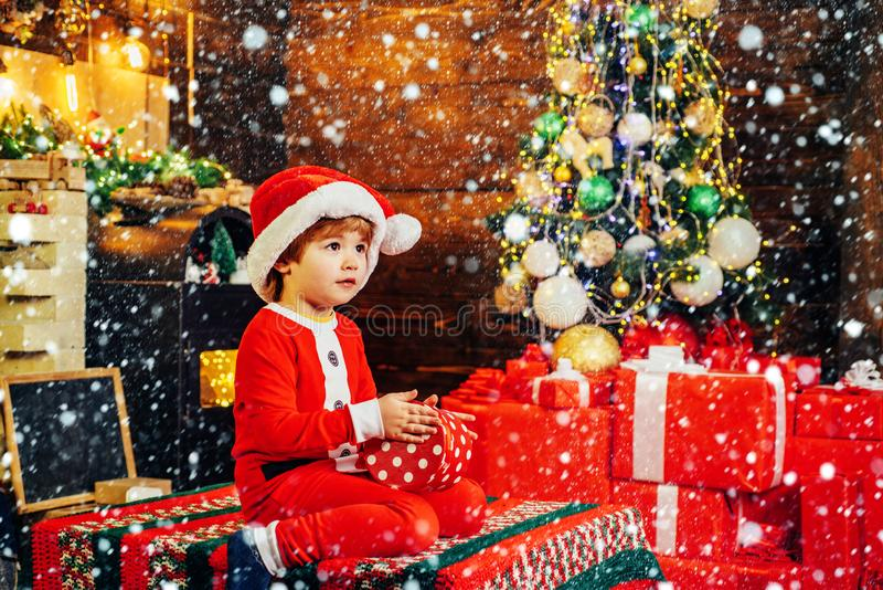 Lovely baby enjoy christmas. Santa boy little child celebrate christmas at home. Family holiday. Boy cute child cheerful royalty free stock photo