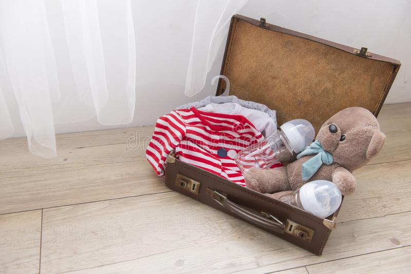 The lovely gift for baby. The lovely baby gift in a small suitcase stock image