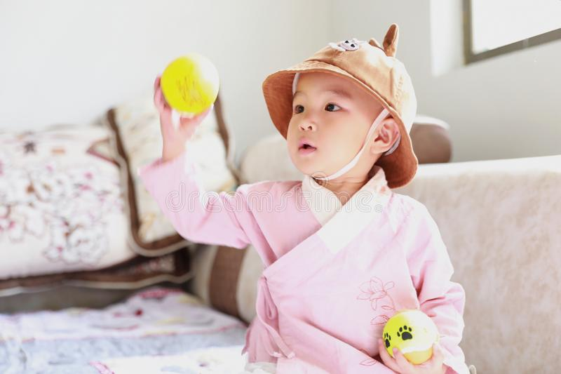 Lovely Baby girl With a hat play on sofa stock image