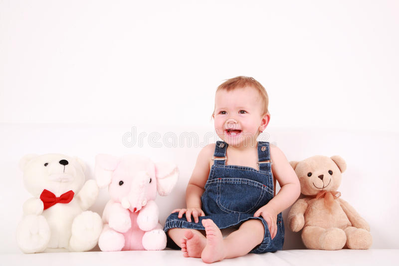 Lovely baby girl with toys royalty free stock image