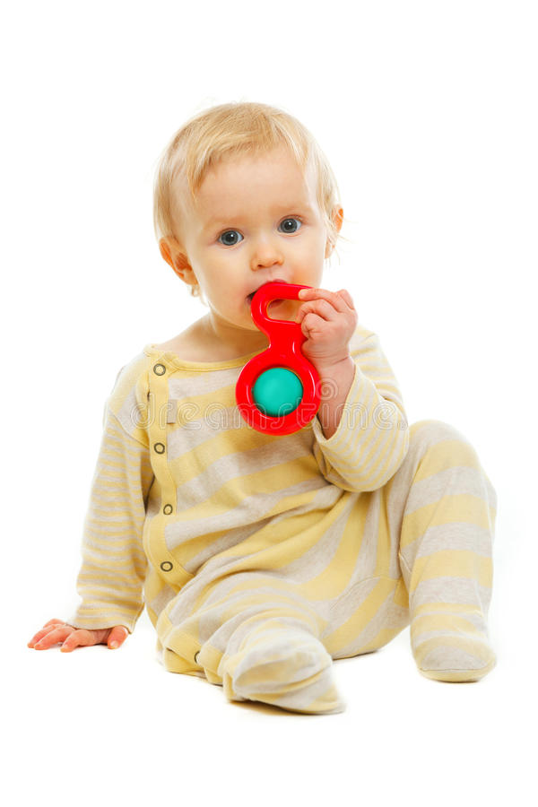Lovely baby playing with rattle on floor stock photos