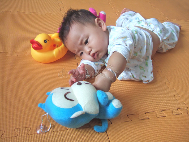 Lovely baby and toys royalty free stock images