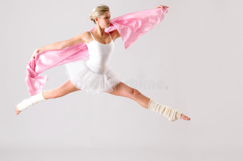 Download Lovely Ballet Dancer Jumping Exercising In Studio Stock Photo - Image: 28246020