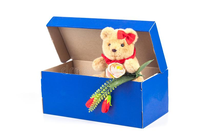Lovely bear toy in blue box gift on white. Background stock photo