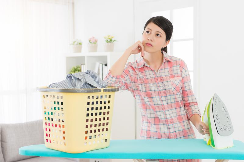 Lovely beauty housewife feeling bored daydreaming stock photos