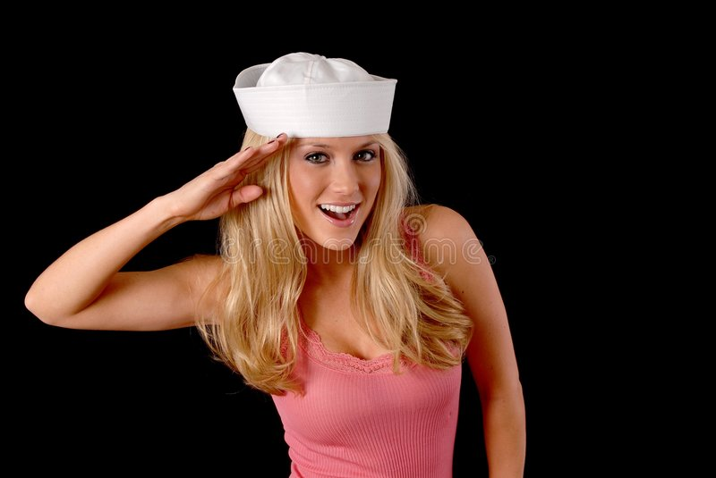Lovely Blond Girl. Isolated lovely and young blond girl wearing a sailor's cap stock images