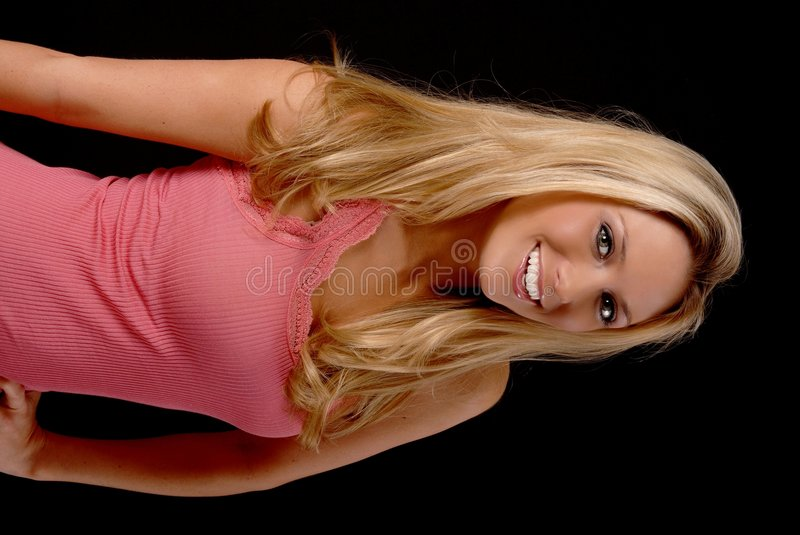 Lovely Blond Girl. Isolated lovely and young blond girl royalty free stock photography