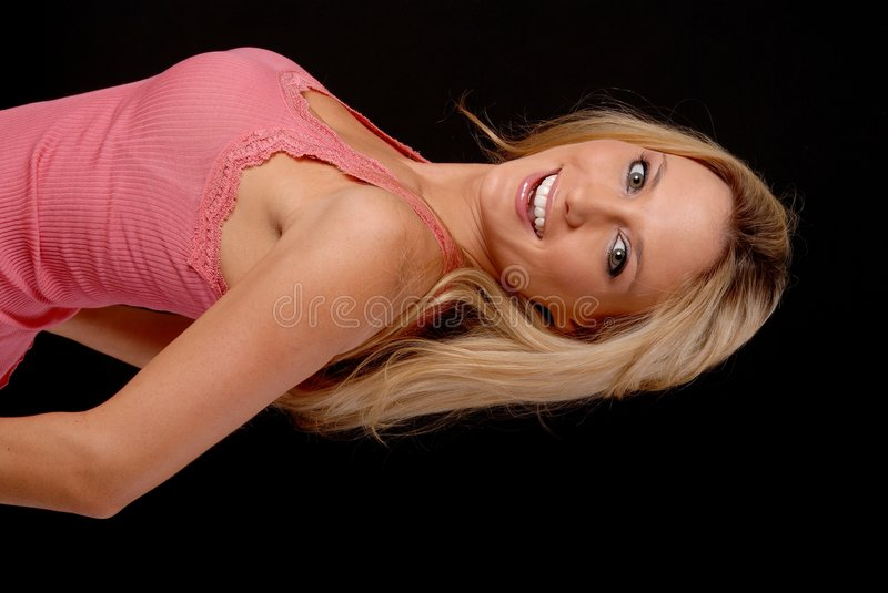 Lovely Blond Girl. Isolated lovely and young blond girl royalty free stock photos
