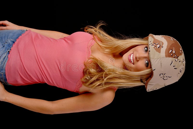 Lovely Blond Girl. Isolated lovely and young blond girl wearing a army helmet stock photos