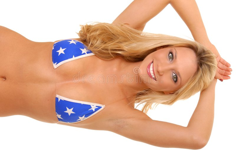 Lovely Blond Girl. Isolated lovely and young blond girl wearing a bikini stock photography