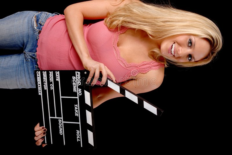 Lovely Blond Girl with a Clap board. Isolated lovely and young blond girl holding a clap board stock photos