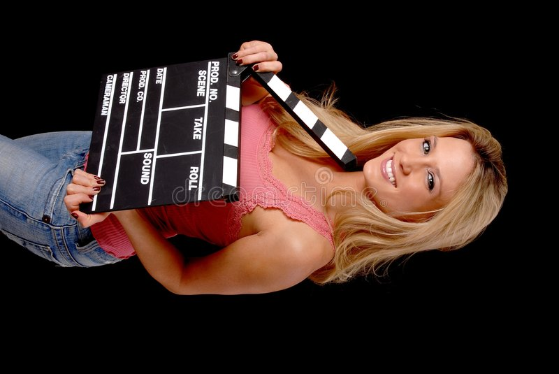 Lovely Blond Girl with a Clap board. Isolated lovely and young blond girl holding a clap board royalty free stock image