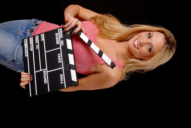Lovely Blond Girl with a Clap board. Isolated lovely and young blond girl holding a clap board stock photography