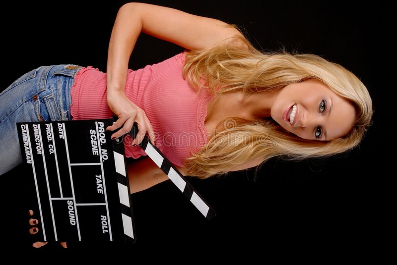 Lovely Blond Girl with a Clap board. Isolated lovely and young blond girl holding a clap board royalty free stock photos