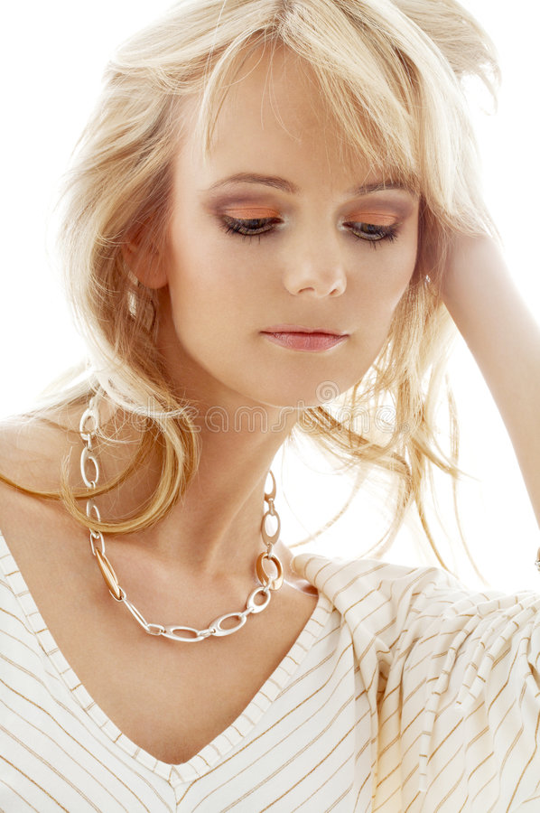 Lovely blond with golden neckl royalty free stock photo
