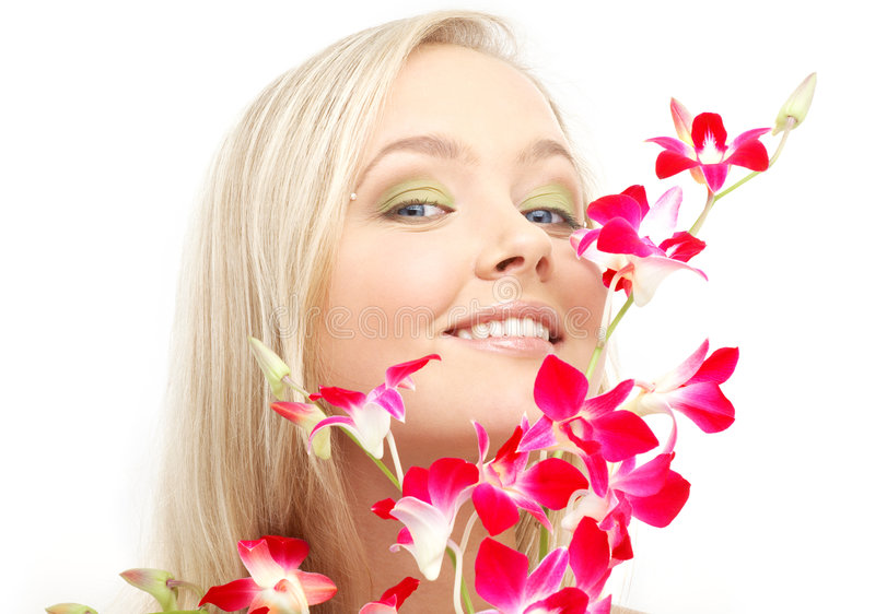 Lovely blond with orchid #2. Bright picture of lovely blond with orchid royalty free stock photos