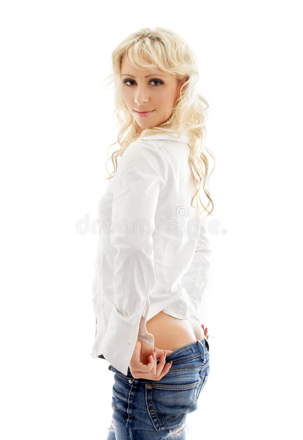 Lovely blond pulling jeans down stock image