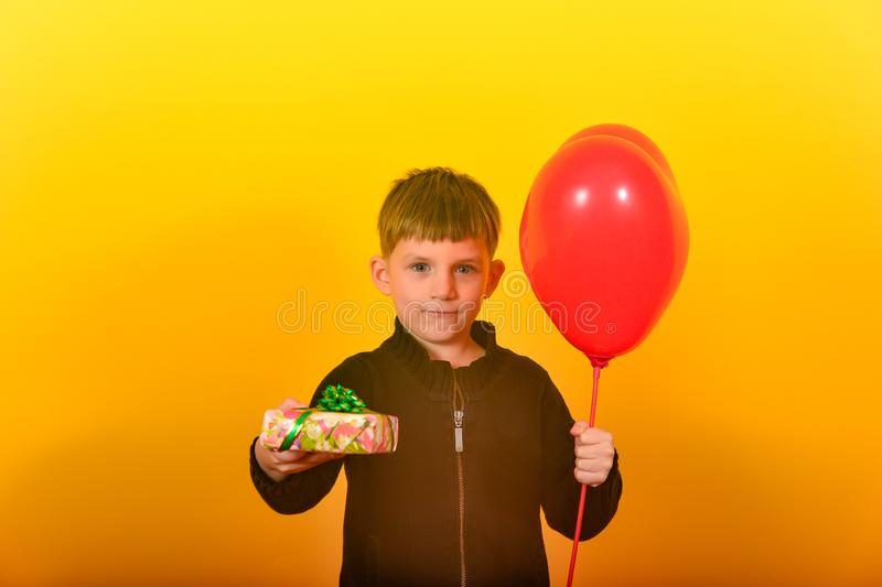 Lovely boy offers a gift.  royalty free stock photo