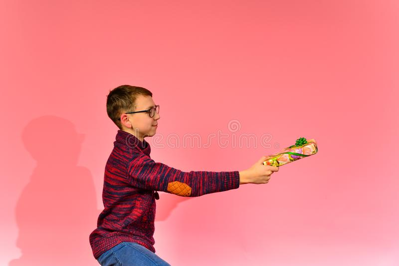 Lovely boy offers a gift.  royalty free stock photos