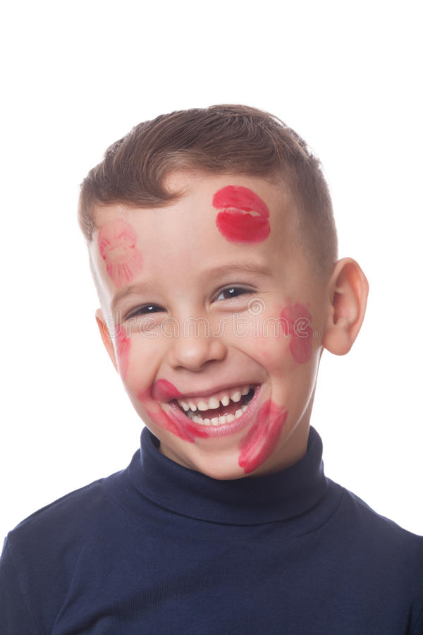 Lovely boy. Smiling lovely boy kissed all over on isolated white stock photos