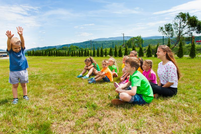 Lovely boy standing in front of group of kids royalty free stock photos