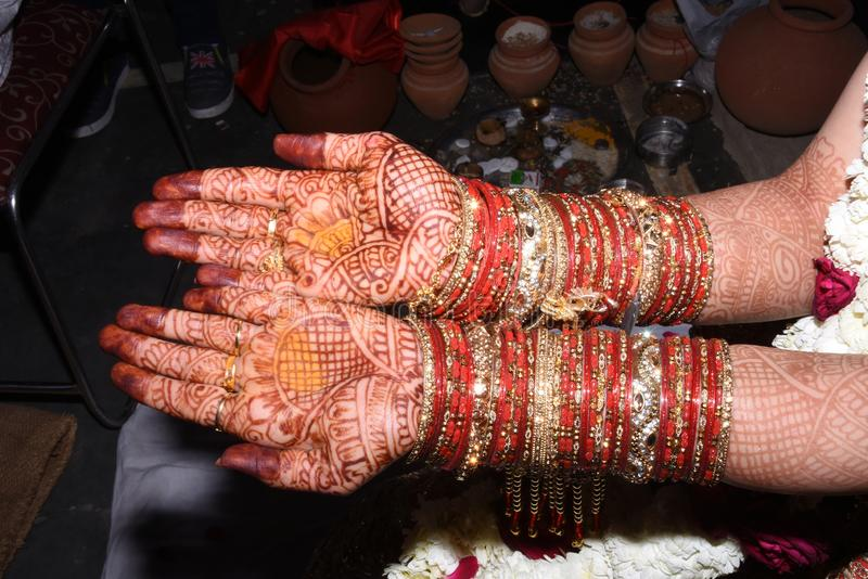 Lovely bridal mehandi on bride hands. royalty free stock photos