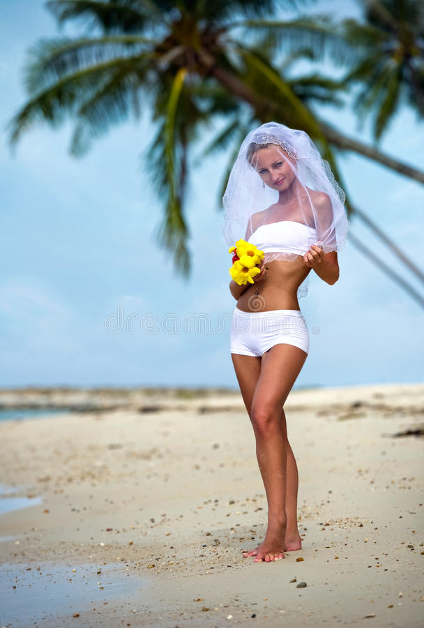 Lovely bride on the beach. Near the sea royalty free stock images