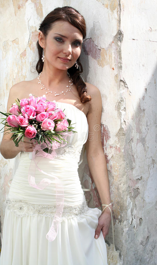 Lovely bride with bouquet royalty free stock photography