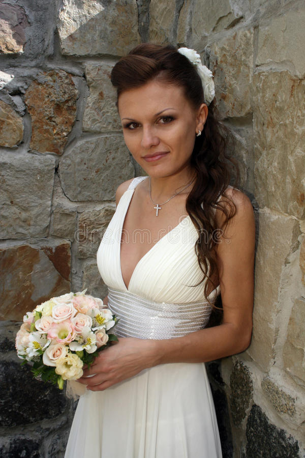 Lovely bride with bouquet stock photos