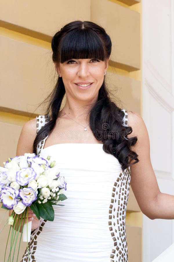 Lovely bride with bouquet royalty free stock photo