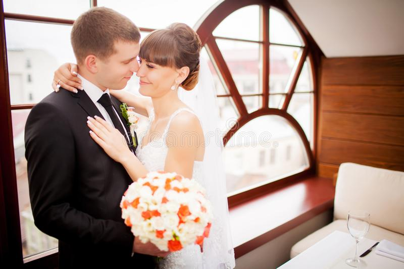 Lovely bride and groom in a beautiful room royalty free stock photos