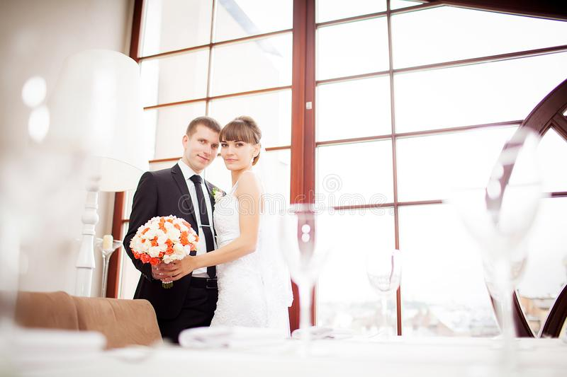 Lovely bride and groom in a beautiful room royalty free stock images