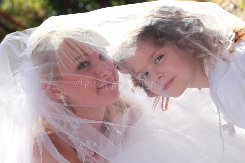Lovely bride and little girl stock photo