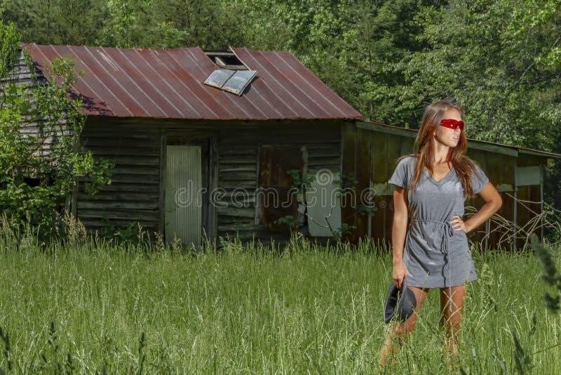 Lovely Brunette Bikini Model Posing Outdoors In A Rural Environment royalty free stock images