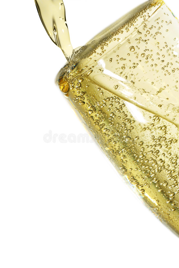 Lovely bubbly. Freshly poured glass of champagne. full to the brim royalty free stock photo
