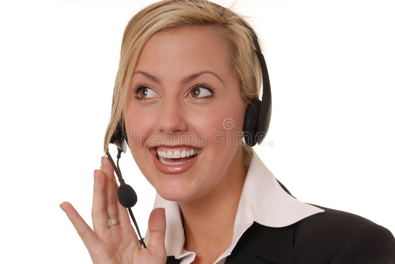 Lovely Business Lady 114. Beautiful and blond business woman with headset royalty free stock photo