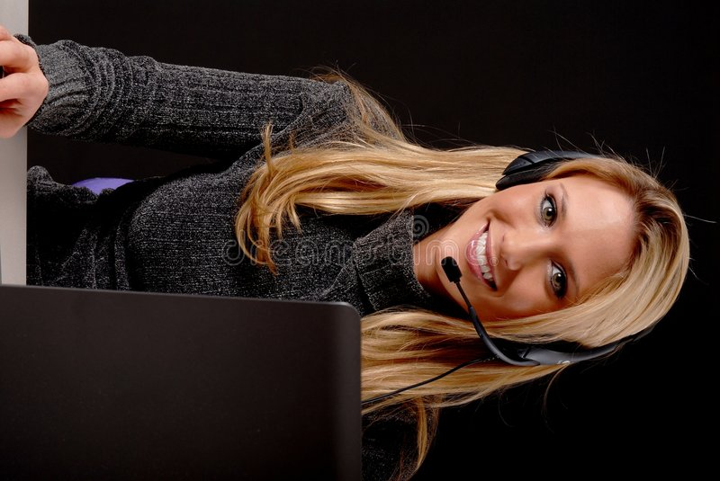 Lovely Business Woman. Lovely blond business woman working at laptop computer stock photography