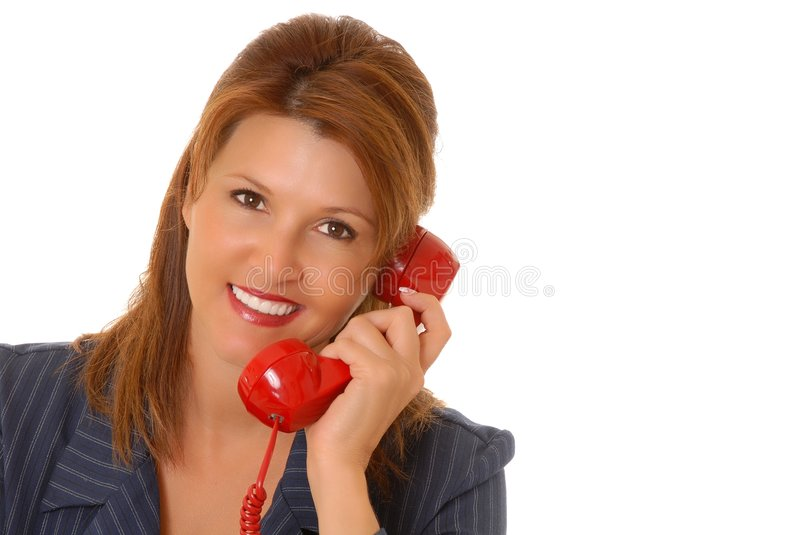 Lovely Business Woman. Lovely brunette business woman talking on a telephone royalty free stock images