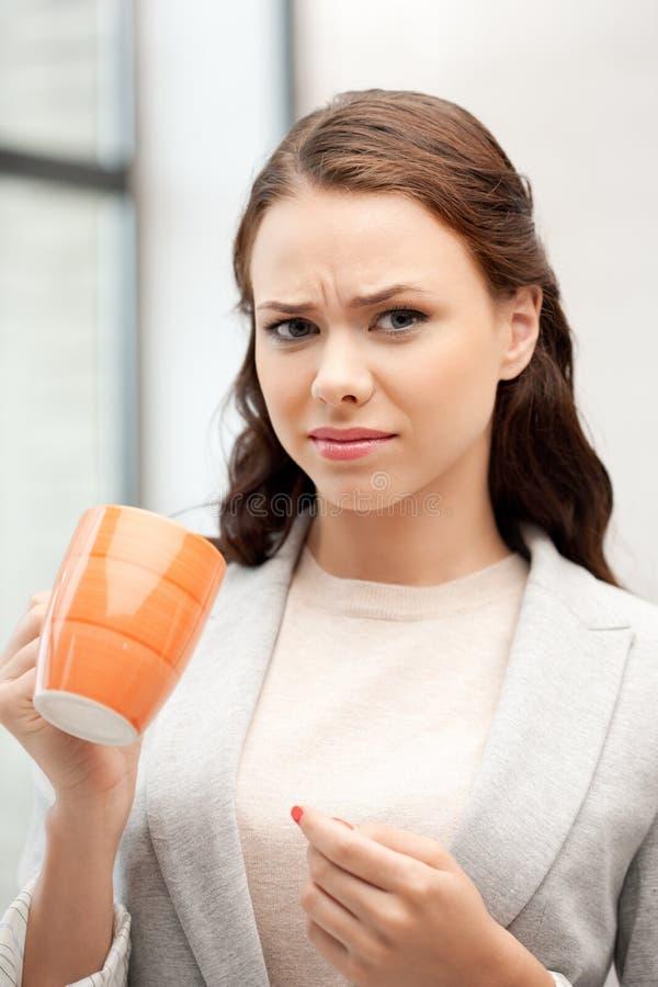Lovely businesswoman with mug stock image