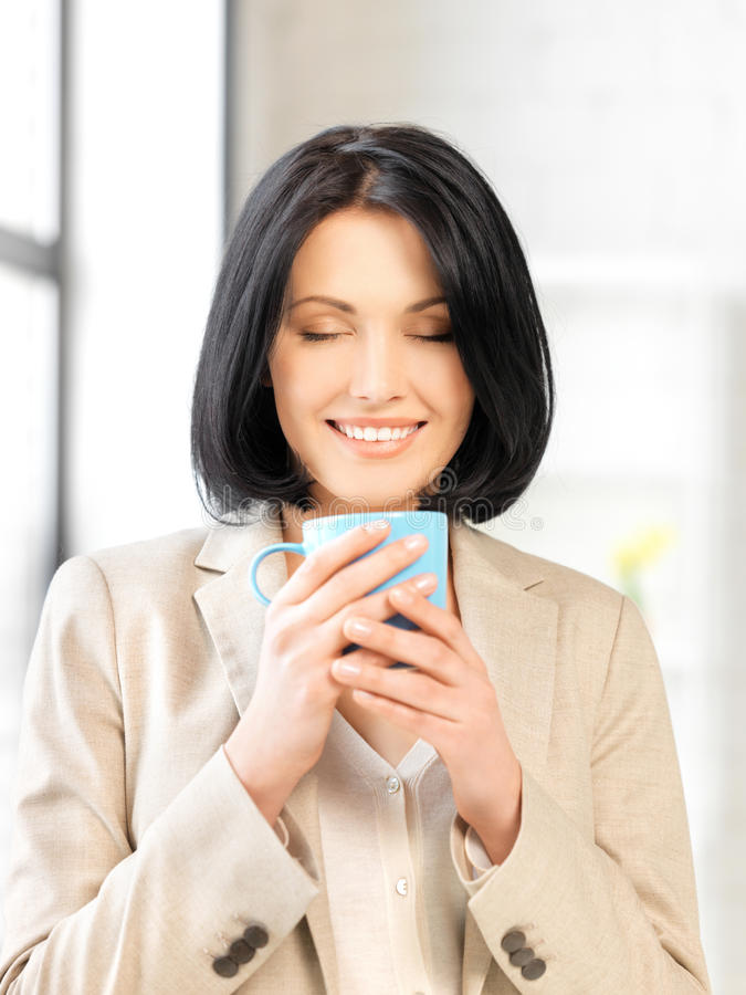 Lovely businesswoman with mug royalty free stock image