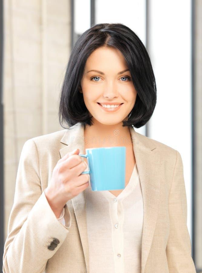 Lovely businesswoman with mug stock photos