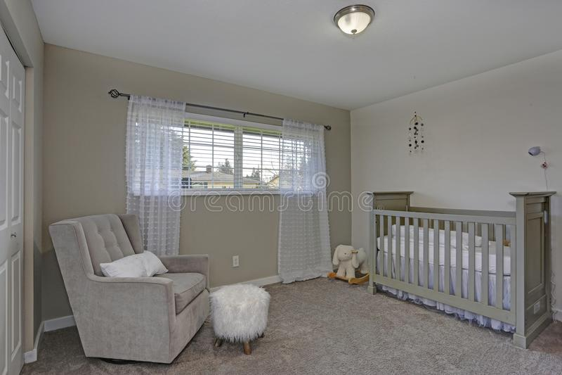 Lovely calm nursery in soft grey colors. Lovely calm nursery in soft grey and beige colors royalty free stock image
