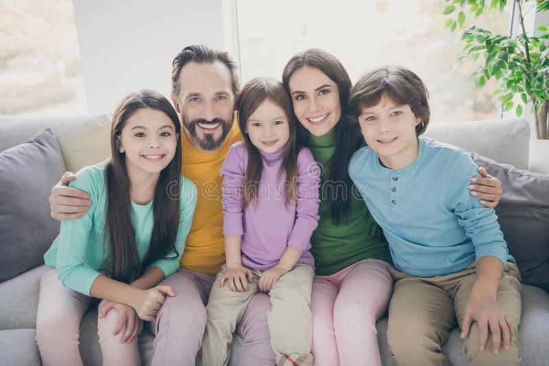 Lovely charming full big family sit couch enjoy spending free time holidays together dad daddy mom mommy hug her preteen stock photography