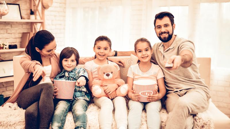 Lovely Cheerful Family Watching Movie at Home royalty free stock photography