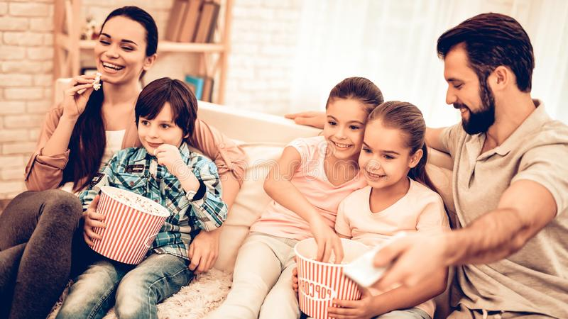 Lovely Cheerful Family Watching Movie at Home stock photography