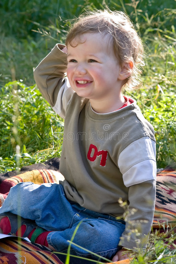 Download Lovely Child Plays To A Grass Stock Image - Image: 2589113