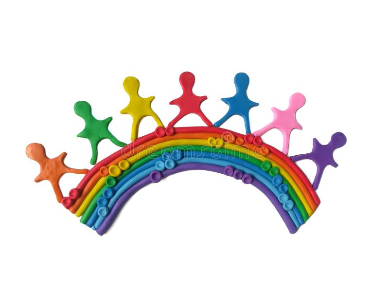 Lovely children on rainbow, colorful plasticine clay dough stock photography