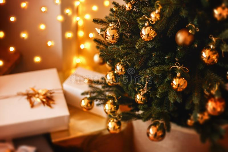 Lovely christmas tree with beautifuly packed presents boxes under it. Lovely christmas tree with beautifuly packed presents and boxes under it royalty free stock image